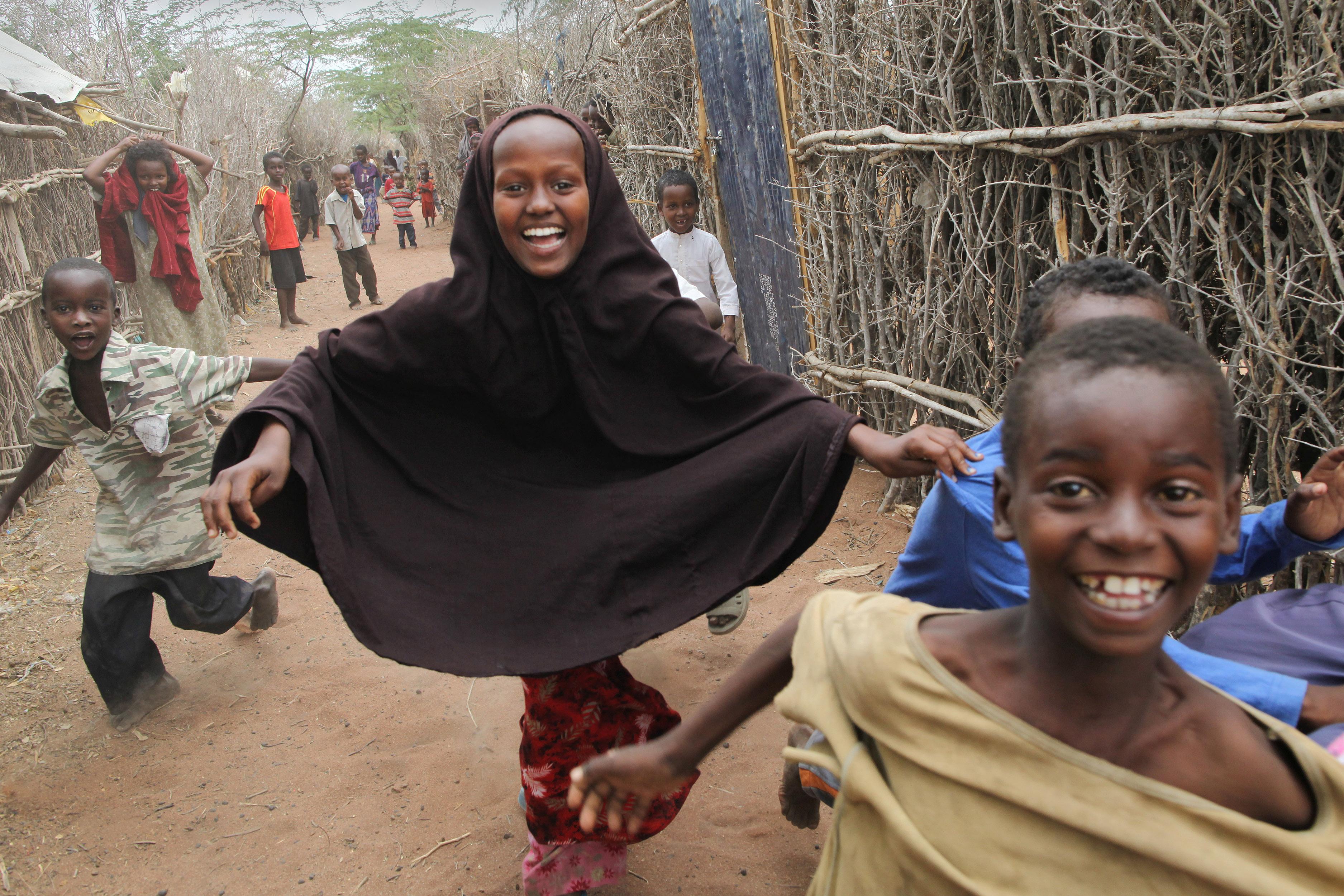 Children running in Dabab refugee camp in Kenya