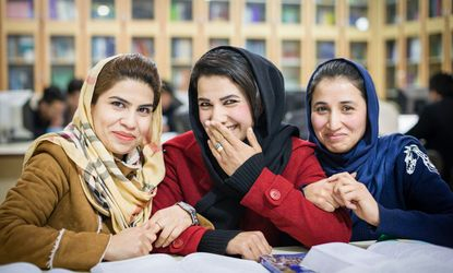Three students at Rana University in Kabul take time to relax between lectures. Advances in the education of women and girls in Afghanistan have been hard-won but they remain fragile.