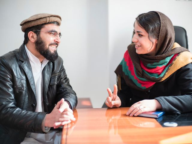 Mozhgan Entazar runs a small organization fighting to improve the pay and standards for women working in factories in Herat. Here she is speaking to a local Imam who shares an office with her.