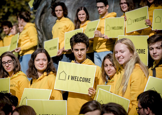 Activists from Amnesty France show that they welcome refugees, Place de la Republique, Paris, October 2016.