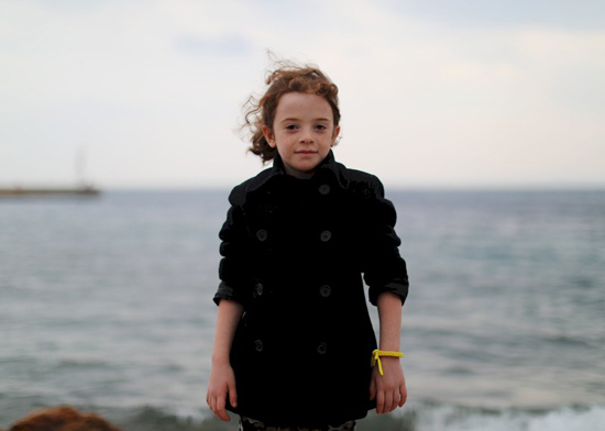 Sarah, aged six, pictured on the Greek island of Chios, 28 November 2016. She can name the capitals of almost all countries in the world. Sarah and her family fled bombing in her home city of Homs. They told Amnesty International that when they tried to cross the border between Syria and Turkey, Turkish police fired shots at them.