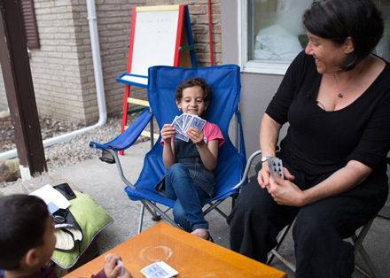 Debbie Rix plays go fish with Aya and Read from Syria