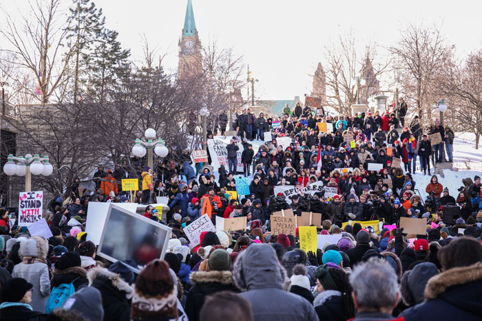 Hundred of people gather in downtown Ottawa for a rally denouncing President Trump's muslim ban