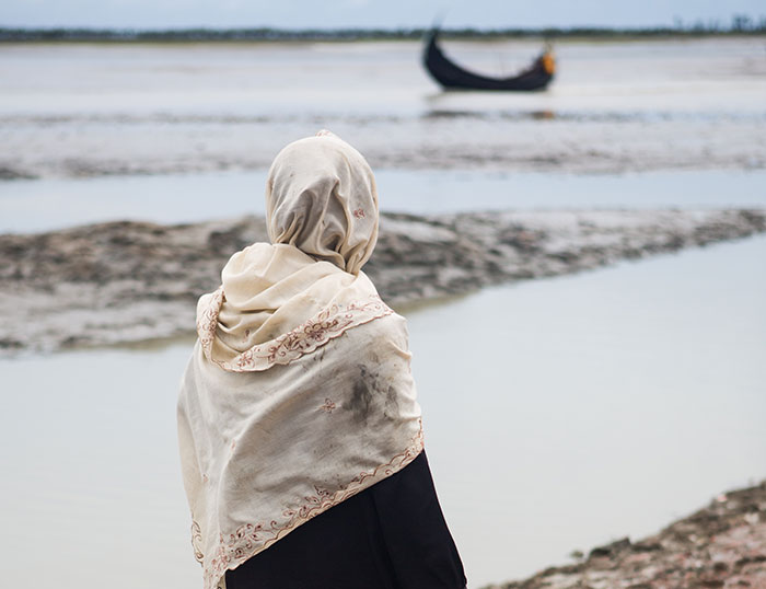 Rohingya woman looking over the water after arriving in Bangladesh