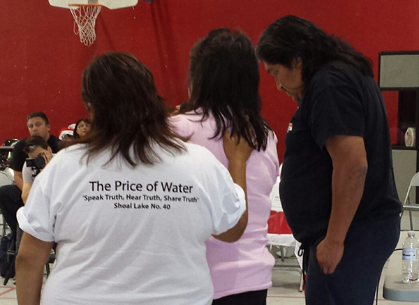 "Community members give moving testimony about the hardships they've faced at a public forum on ""The Price of Water"""