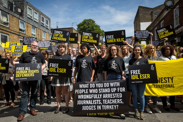 Amnesty members protest imprisonment of the Instabul 10 in London