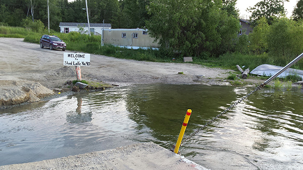 Cut off on an artificial island, the people of Shoal Lake #40 rely on a ferry barge for access to every day essentials