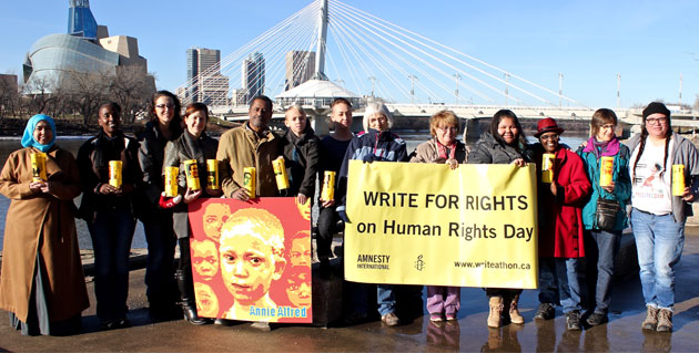 Amnesty Members in Winnipeg with a Write for Rights Sign